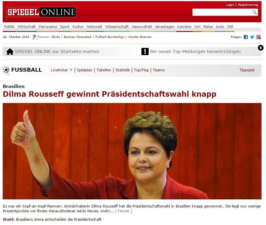 """26.out.2014 - A publicação alemão """"Der Spiegel"""" diz que a presidente Dilma Rousseff (PT) foi reeleita em uma disputa apertada neste domingo, """"apenas alguns pontos à frente do adversário Aécio Neves (PSDB)"""""""