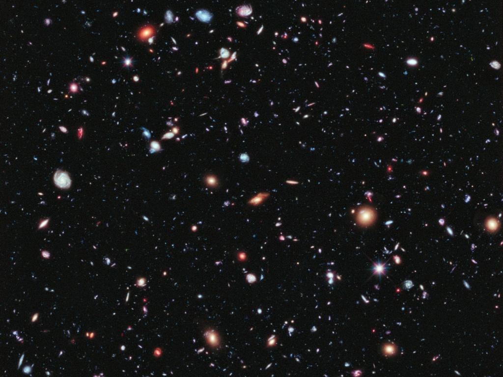 6.nov.2014 - GALÁXIAS DISTANTES - A imagem, obtida pelo telescópio Hubble da Nasa (agência espacial americana), mostra mais de 5.000 galáxias. Segundo a agência, algumas delas tem mais de 13,2 bilhões de anos e são as galáxias mais distantes já observadas