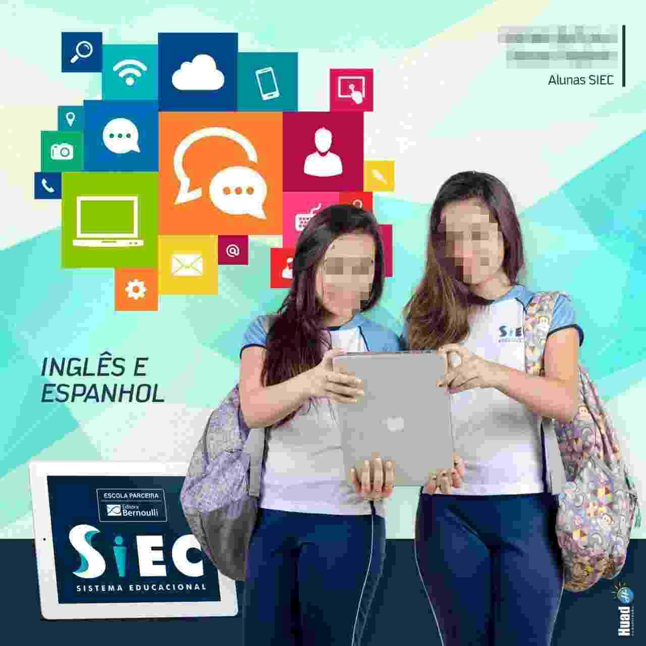 Escola Siec - Sistema Educacional, em Bocaiúva (MG), virou piada nas redes sociais depois de publicar fotos de alunos segurando notebooks como se fosse tablets - Reprodução/Facebook