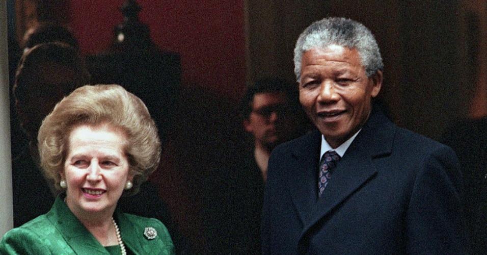4.jul.1990 - Nelson Mandela encontra em Londres a então primeira-ministra britânica, Margaret Thatcher, após sair da prisão