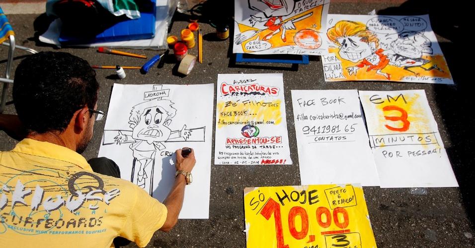 12.abr.2015 - Chargista aproveita protesto contra o governo da presidente Dilma Rousseff para fazer vários cartazes na avenida Paulista, em São Paulo