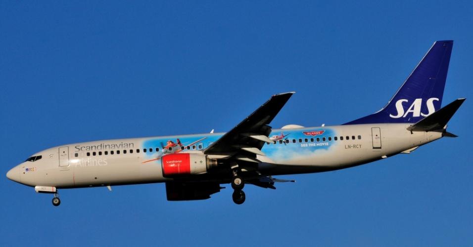 """Aviões desenhados em um avião: a escandinava SAS estampo os personagens do filme """"Aviões"""", da Disney, em seu Boeing 737-800"""