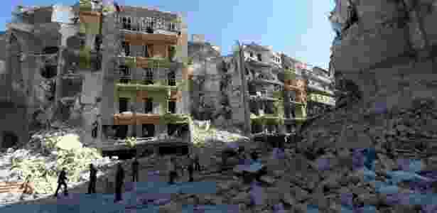 Cerca de 250 mil pessoas já morreram na guerra síria. Na foto, a cidade de Aleppo - Zein Al-Rifai/AMC/AFP