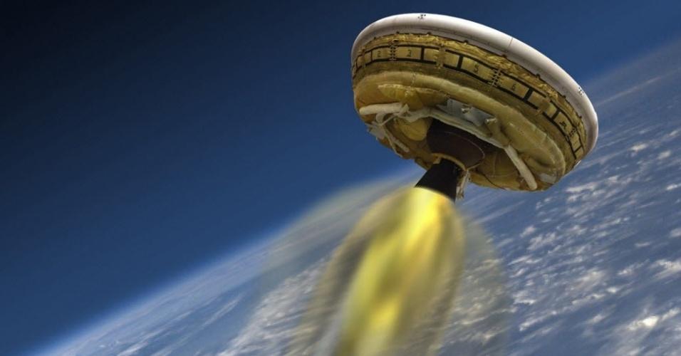 2.jun.2015 - Concepção artística do veículo de teste da Nasa (agência espacial norte-americana) batizado de Desacelerador Supersônico de Baixa Densidade (LDSD, na sigla em inglês), que foi desenhado para testar tecnologias de aterrissagem para futuras missões a Marte. O lançamento-teste da aeronave foi abortado devido às más condições marítimas no Havaí, EUA. As ondas estavam muito altas, o que não permitiria a recuperação do módulo quando retornasse à Terra, informou a Nasa. A agência espacial deverá fazer nova tentativa nesta quarta-feira (3)