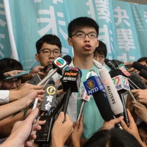 """Joshua Wong, um dos rostos mais conhecidos da """"revolução dos guarda-chuvas"""", daria uma palestra em Bancoc"""