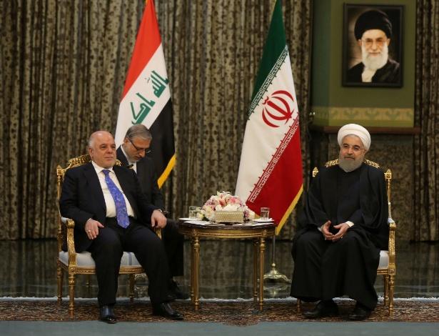 Presidente iraniano, Hassan Rouhani, em encontro com o primeiro-ministro iraquiano Haider Al-Abadi, em Teerã