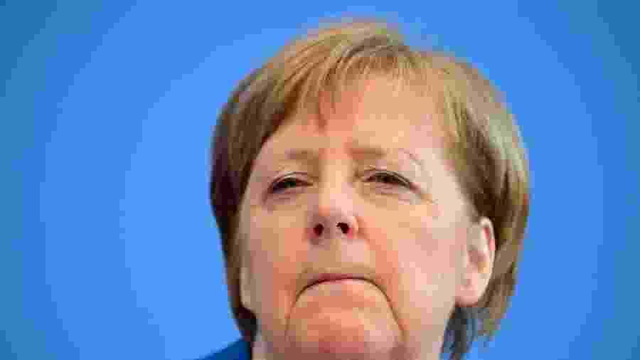 A chanceler alemã Angela Merkel em coletiva de imprensa sobre o novo coronavírus - Tobias Schawrz/AFP