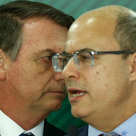 O presidente Jair Bolsonaro, acompanhado do governador do RJ Wilson Witzel - Pedro Ladeira/Folhapress