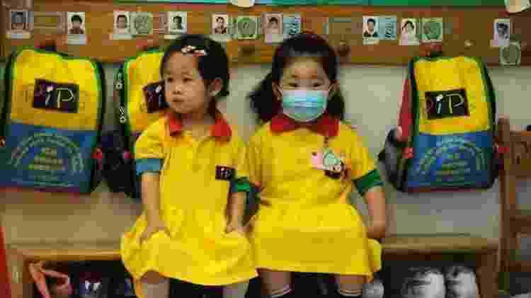 Crianças na escola durante pandemia de H1N1 em Hong Kong - AFP - AFP