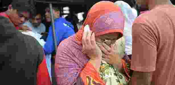 Mulher chora a morte de um parente vítima do terremoto, em Pidie Jaya - Chaideer Mahyuddin/ AFP