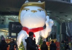 Shopping inaugura estátua de cão com cara de Trump na China - AFP
