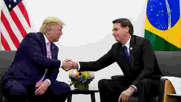 Donald Trump e Jair Bolsonaro durante encontro bilateral no G20, em Osaka, Japão, em 2019 - Kevin Lamarque/Reuters - Kevin Lamarque/Reuters