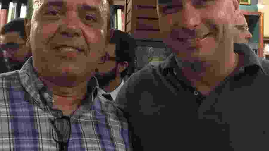 O procurador Marcelo Monteiro e o senador Flávio Bolsonaro em foto exibida em redes sociais - Reprodução de redes sociais