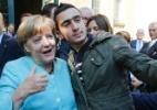 Refugiado sírio que fez selfie com Merkel sofre perseguição por causa da foto - Fabrizio Bensch/Reuters