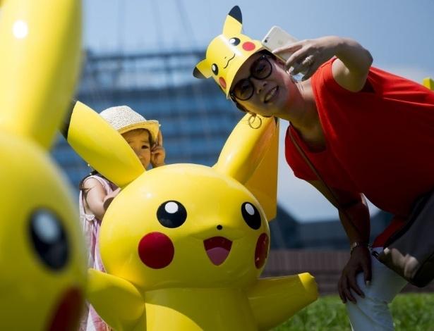 13.ago.2016 - Pikachu saiu do esquecimento direto para a fama. Mas na cidade japonesa de Yokohama ele nunca foi esquecido e tem até uma parada anual, que ganhou novos participantes com o lançamento do jogo Pokémon Go