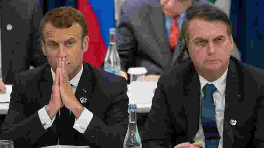 O presidente da França, Emmanuel Macron, e Jair Bolsonaro durante o encontro do G20, em Osaka (Japão) - Jacques Witt - 28.jun19/AFP