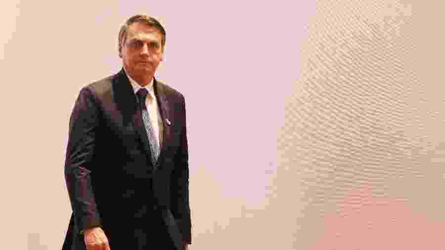 Jair Bolsonaro chega para a foto oficial da cúpula do G20, que está acontecendo em Osaka, no Japão -  ludovic MARIN / AFP