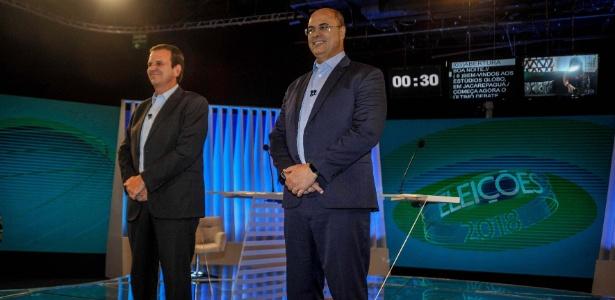 25.out.2018 - Os candidatos ao governo do Rio Eduardo Paes (à esq.) e Wilson Witzel (à dir.)