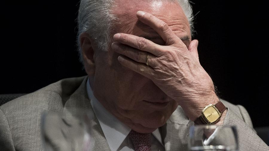 9.abr.2018 - O ex-presidente Michel Temer em cerimônia no BNDES  - Advogado de Temer diz que entrará com pedido de habeas corpus