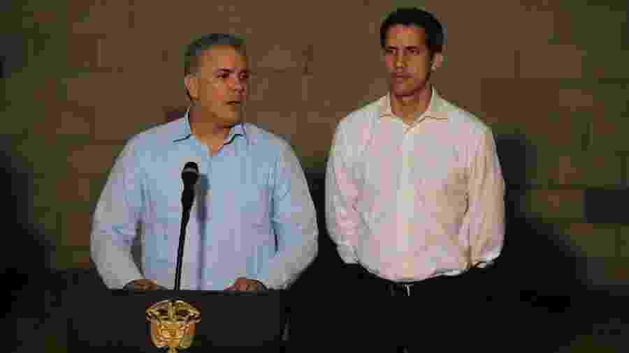 23.fev.2019 - O presidente colombiano, Ivan Duque (à dir.), ao lado do autoproclamado presidente interino da Venezuela, Juan Guaidó, falam com a imprensa após confrontos nas fronteiras da Venezuela - Luisa Gonzalez/Reuters