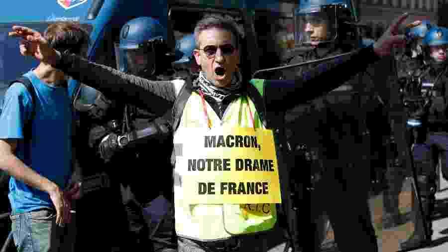 Manifestante compara tragédia na catedral de Notre-Dame ao presidente da França, Emmanuel Macron - Zakaria Abdelkafi/AF