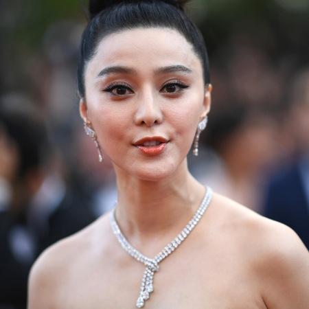 8.mai.2018 - Atriz Fan Bingbing posa no tapete vermelho do Festival de Cannes  - Loic Venance/AFP