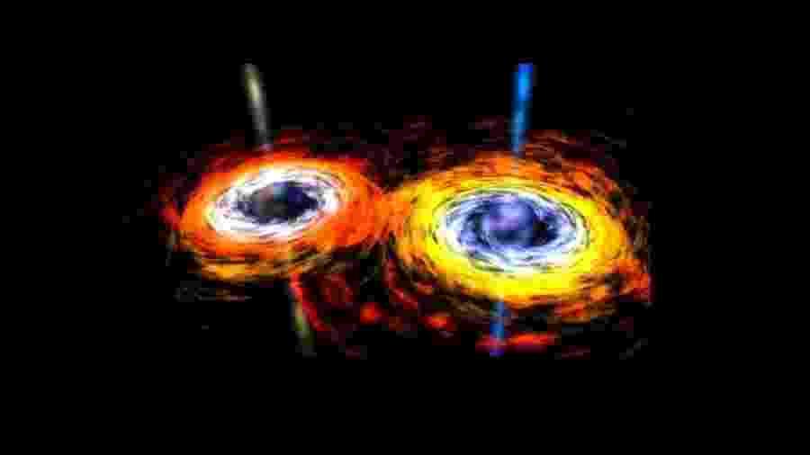 Arte de dois buracos negros perto de se fundirem - Reprodução NASA
