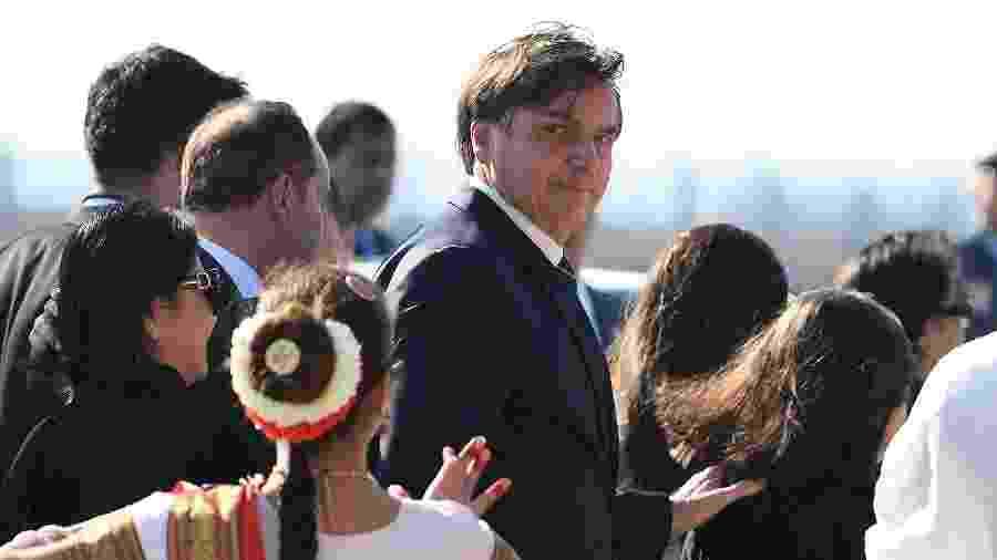 O presidente Jair Bolsonaro desembarcou em Nova Déli, na Índia, onde participa de reuniões para estreitar relações comerciais - Prakach Singh/AFP