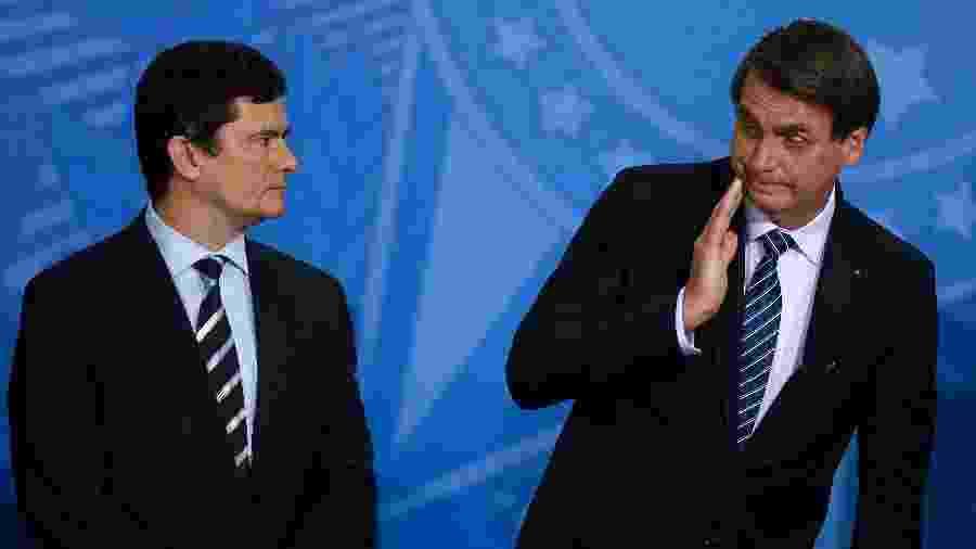 O presidente Jair Bolsonaro e ministro Sérgio Moro (Justiça), durante lançamento, no Planalto, de programa contra violência nas cidades - Pedro Ladeira/Folhapress