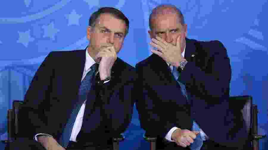 13.jun.2019 - O Presidente Jair Bolsonaro e o ministro da Casa Civil Onyx Lorenzoni - Andre Coelho/Folhapress