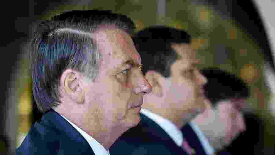 O presidente da República, Jair Bolsonaro (sem partido), com os presidentes do Senado, Davi Alcolumbre (DEM-AP), e da Câmara, Rodrigo Maia (DEM-RJ) - Carolina Antunes/PR