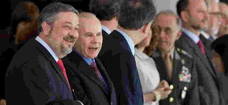 Antonio Palocci e Guido Mantega no Palácio do Planalto, aguardam chegada do presidente americano Barack Obama, em 2011 - Lula Marques/Folhapress