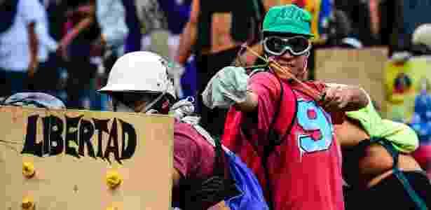 Opositores de Maduro protestam em meio a greve de 48 horas nas ruas de Caracas - Ronaldo Schemidt/AFP Photo