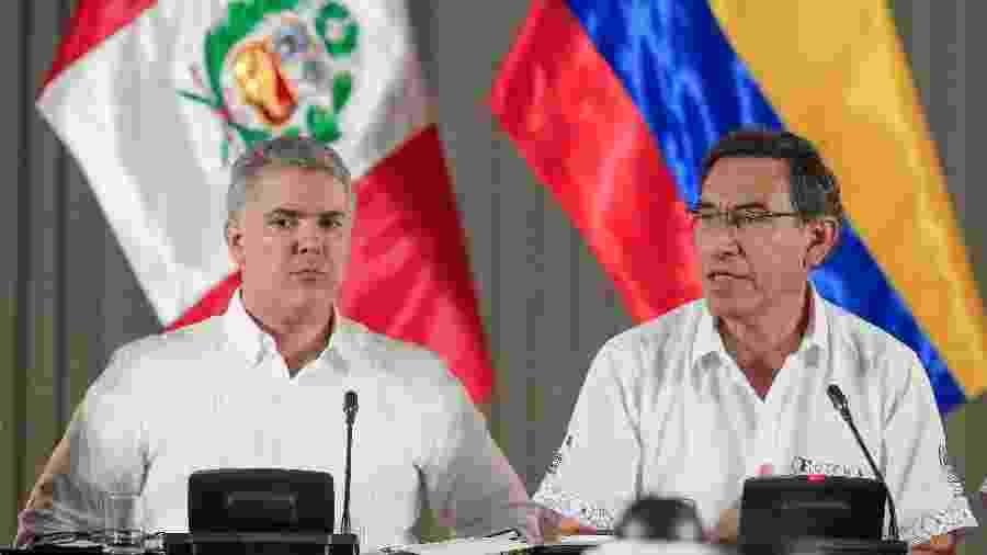 27.ago.2019 - O presidente colombiano, Iván Duque (à esq.), ao lado do presidente peruano, Martín Vizcarra - Carla PAT/Peruvian Presidency/AFP