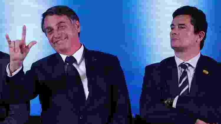 O presidente Jair Bolsonaro (à esq.) e o ministro Sergio Moro - Rodolfo Buhrer/Foto Arena/Estadão Conteúdo