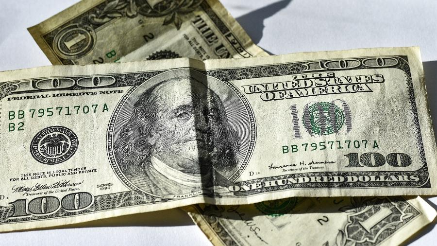 Nota; dinheiro; dólares; US$ 100; cem - Getty Images/iStockphoto