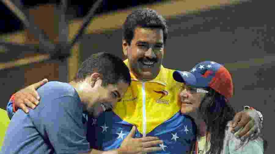 """Nicolás Maduro e sua família: a esposa Cilia Flores e o filho """"Nicolasito"""" Maduro - AFP"""
