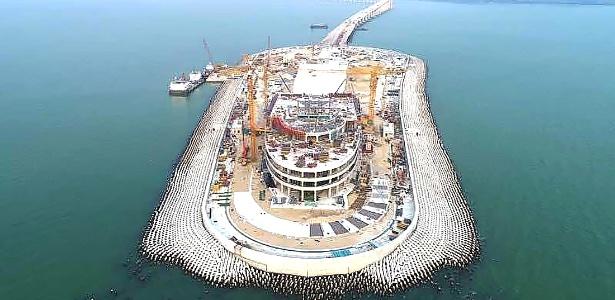 Ilha artificial está sendo construída como parte da ponte do Delta