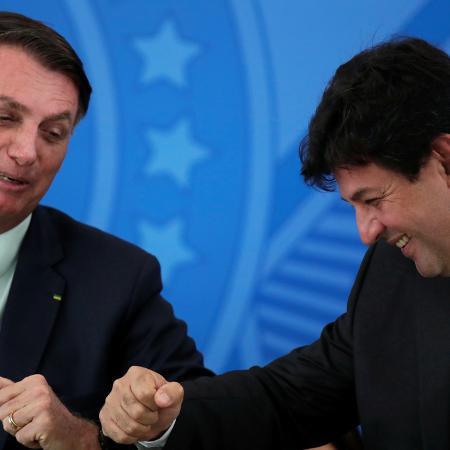 O presidente do Brasil, Jair Bolsonaro, e o ex-ministro da Saúde, Luiz Henrique Mandetta - UESLEI MARCELINO/REUTERS
