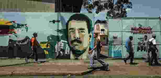 27.mai.2016 - Mural retratando o presidente da Venezuela, Nicolás Maduro, é visto em Caracas - Meridith Kohut/The New York Times - Meridith Kohut/The New York Times