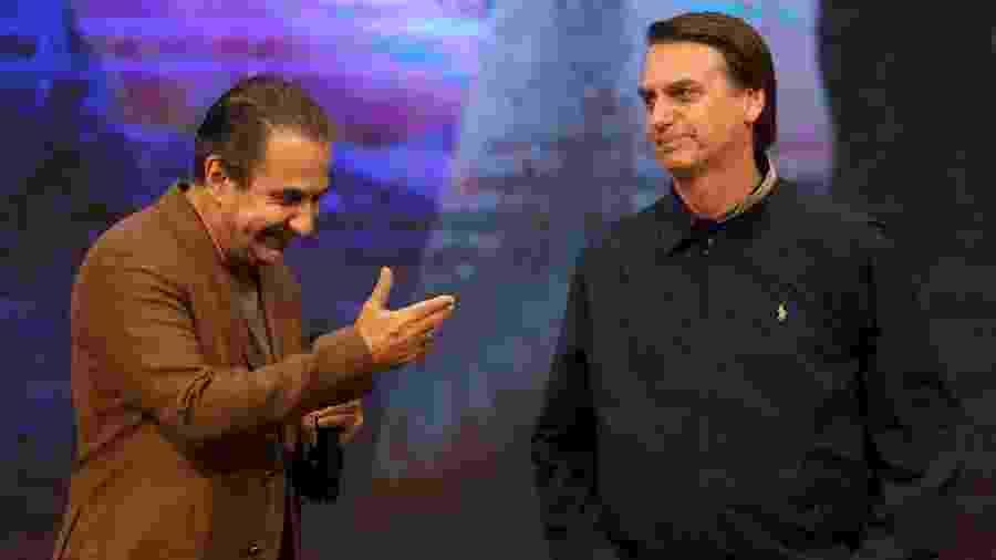 O pastor Silas Malafaia e o presidente Jair Bolsonaro em culto no Rio em 2018 - Wilton Junior - 30.out.2018/Estadão Conteúdo