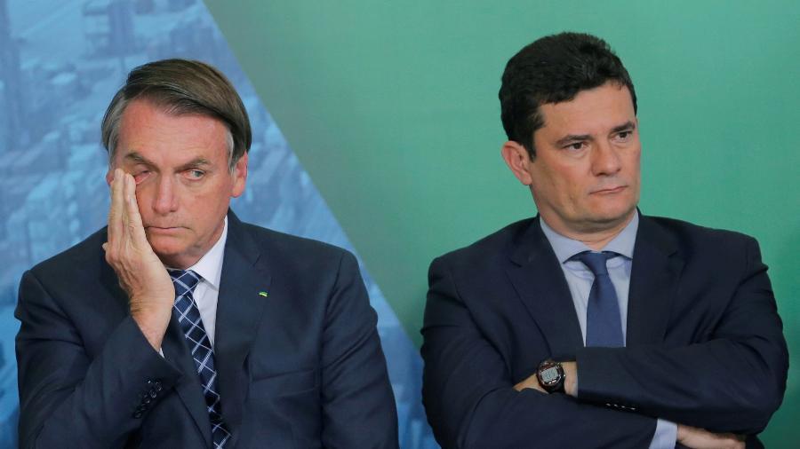 Presidente Jair Bolsonaro e ministro da Justiça, Sergio Moro, em cerimônia no Palácio do Planalto - Reprodução