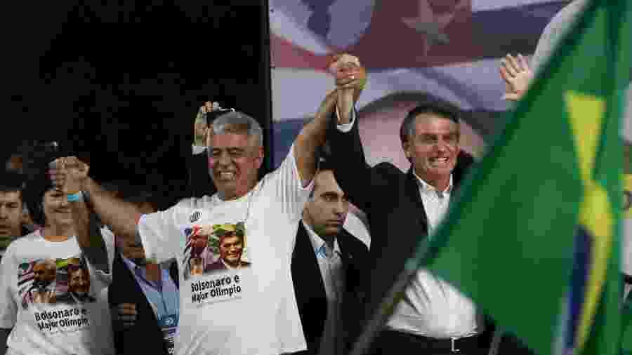 5.ago.2018 - Major Olímpio (e) e Jair Bolsonaro, candidatos ao Senado e à Presidência, participam da convenção do PSL-SP em São Paulo - Zanone Fraissat/Folhapress