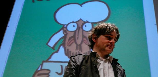 """4.jul.2015 - O diretor do jornal satírico francês """"Charlie Hebdo"""", Laurent Sourisseau, participa de conferência no 10º Congresso Internacional de Jornalismo Investigativo, organizado pela Associação Brasileira de Jornalismo Investigativo (ABRAJI), em São Paulo - Carlos Villalba/EFE"""