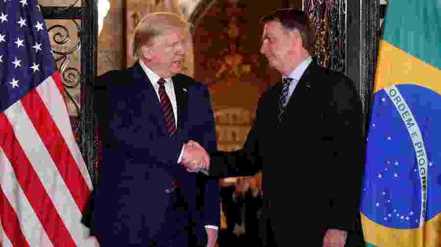 Presidente dos EUA, Donald Trump, e presidente Jair Bolsonaro em encontro na Flórida, em março - TOM BRENNER