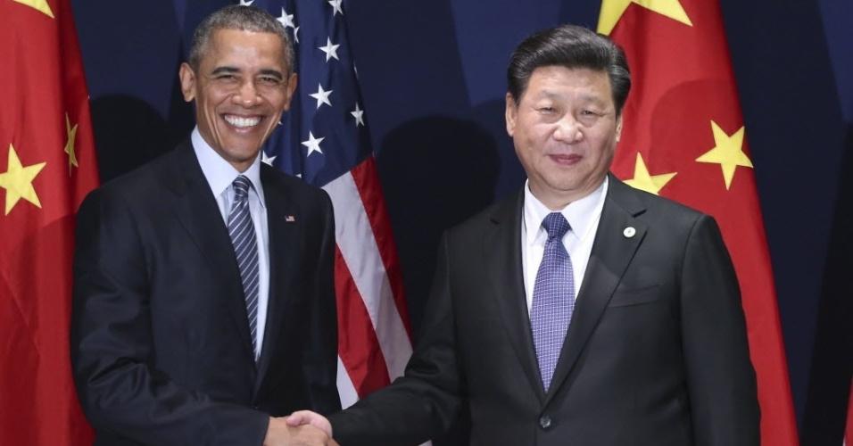 3.dez.2015 - O presidente chinês, Xi Jinping (à dir.), se encontrou com o presidente dos Estados Unidos, Barack Obama (à esq.), durante Conferência do Clima da ONU (Organização das Nações Unidas), em Paris, na França