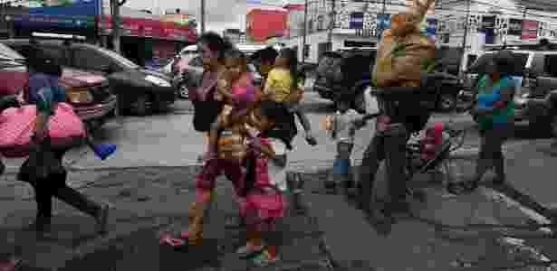 17.out.2018 - Caravana tem gente de todas as idades, incluindo crianças - Orlando Sierra/AFP - Orlando Sierra/AFP