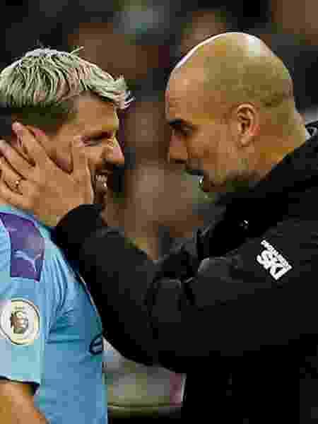 Sergio Agüero e Pep Guardiola - ANDREW YATES