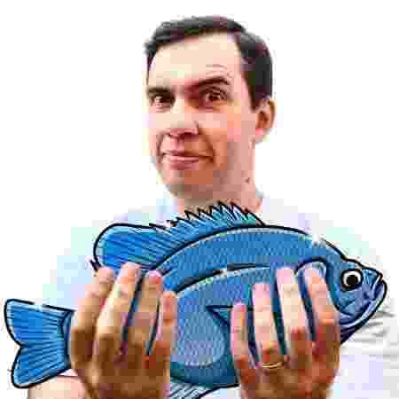 segurando peixe - Felipe Tomazelli - Felipe Tomazelli