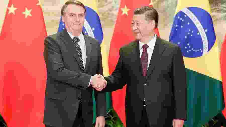 Bolsonaro e o presidente chinês Xi Jinping se cumprimentam - Divulgação/Isac Nóbrega/Presidência da República